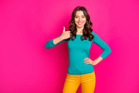 Pgoto of wavy cheerful positive nice cute pretty millennial showing you thumb up smiling toothily emphasizing high quality of product isolated bright pink color background