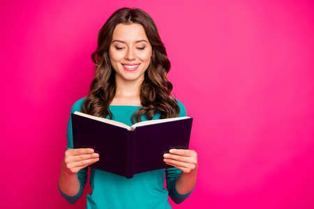 Photo of cheerful positive nice cute charming girlfriend looking thorugh her copybook in search of answers to questions she has smiling toothily isolated fuchsia color vivid background Stock fotó