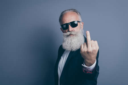 Close-up portrait of his he nice attractive chic classy brutal serious mean gray-haired man demonstrating offensive behavior showing middle finger isolated over dark grey pastel color background