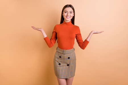 Photo of cute charming girlfriend agent woman showing you two ways of solving problem wearing skirt turtleneck isolated beige pastel color background Stock Photo