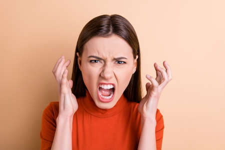 Close-up portrait of her she nice attractive crazy outraged gloomy frustrated wild desperate straight-haired girl expressing rage despair isolated over beige pastel color background
