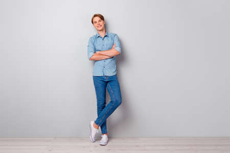 Full size photo of masculine smat worker guy cross his hands enjoy work job look in camera wear casual style outfit isolated over grey color background
