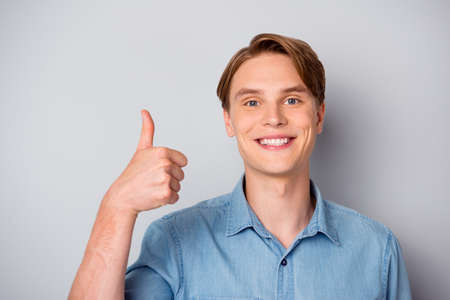 Close up photo of positive cheerful guy recommend perfect promo ads show thumb-up sign wear modern outfit isolated over grey color background