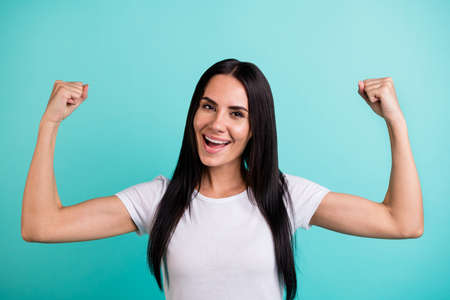 Close-up portrait of nice attractive cheerful straight-haired girl showing muscles motivation sportive life lifestyle isolated on bright vivid shine vibrant teal green blue turquoise color background