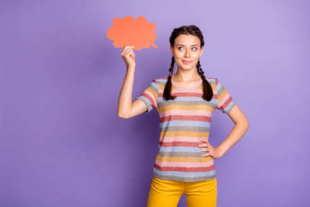 Photo of beautiful lady holding big red mind cloud reading banner creative text words wear casual striped t-shirt yellow trousers isolated purple color background