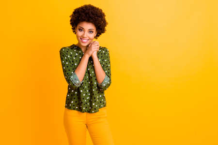 Porrait of positive calm peaceful afro american girl put hands fists together feel grateful wear good look clothing isolated over vivid color background