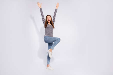 Full length body size view of her she nice attractive charming cheerful cheery overjoyed straight-haired girl rising hands up having fun best news isolated over white light background
