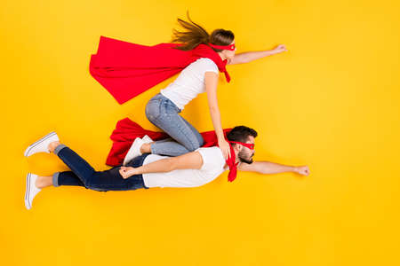 Top view above high angle flat lay flatlay lie view concept of her she his he focused strong successful people flying to goal isolated on bright vivid shine vibrant yellow color background