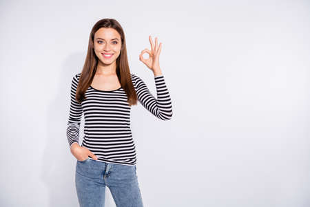 Portrait of her she nice attractive winsome shine charming cute lovely pretty cheerful cheery positive content straight-haired girl showing ok-sign isolated over white light background