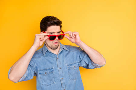 Portrait of his he nice attractive wondered content virile masculine, guy putting of specs wow expression isolated over bright vivid shine vibrant yellow color background
