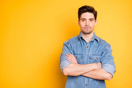 Photo of serious confident man with hands folded staring at you listening interested isolated bright color background