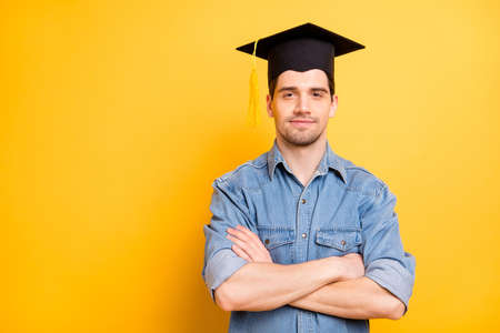 Photo of confident serious worker having graduated from universite able to do all assignments required with hands folded isolated vivid color background Фото со стока