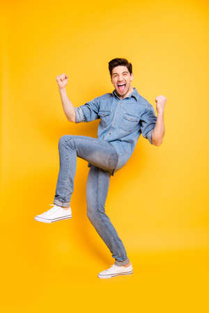 Vertical full length body size view of his he nice attractive crazy cheerful cheery funky guy celebrating good news isolated over bright vivid shine vibrant yellow color background