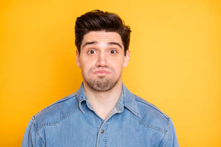 Close-up portrait of his he nice attractive handsome funky comic guy holding air in cheeks grimacing isolated over bright vivid shine vibrant yellow color background