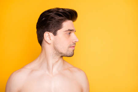 Close-up portrait of his he nice attractive handsome well-groomed pure naked nude guy looking aside daily facial care hydration isolated over bright vivid shine vibrant yellow color background