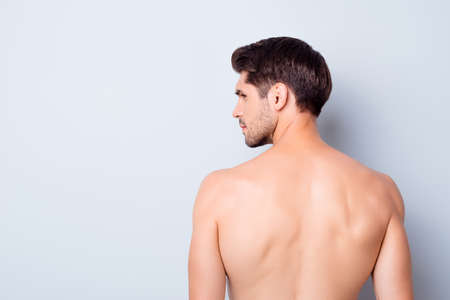 Back rear profile side photo of serious brutal guy look copyspace feel thoughtful about skincare man spa salon treatment isolated over grey color background
