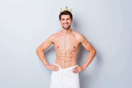 Portrait of his he nice attractive content well-groomed brunette cheerful cheery guy wearing tiara wrapped in towel after spa isolated over light white grey color pastel background Banque d'images