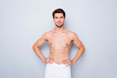 Photo of handsome macho man guy white towel around hips after taking morning shower torso masculine body isolated grey background