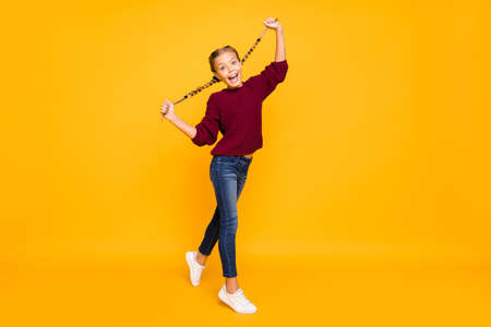 Full length body size view of her she nice attractive lovely girlish crazy comic cheerful cheery pre-teen girl having fun time fooling isolated on bright vivid shine vibrant yellow color background Standard-Bild