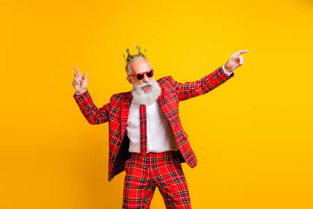 Photo of cool trendy look grandpa white beard dancing hip-hop strange moves wear crown sun specs plaid red blazer tie pants outfit isolated yellow color background