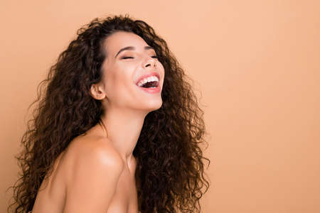Close up side profile photo beautiful amazing she her model lady ideal appearance eyes closed laughing pure silky skin condition sincere slim skinny wear no clothes isolated beige pastel background