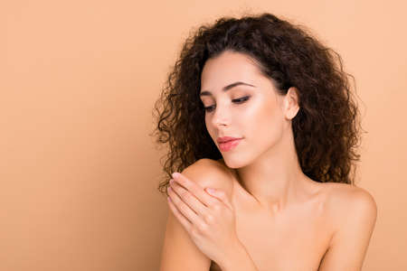 Close up photo beautiful she her lady smearing hand arm fingers balm body shoulder skin healthy soft silky shiny ideal condition use new soap gel shower wearing no clothes isolated beige background 写真素材
