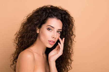Close up side profile photo beautiful amazing she her model lady touch perfect cheekbone fingers smearing lotion soft body ideal brilliant appearance wear no clothes isolated beige pastel background