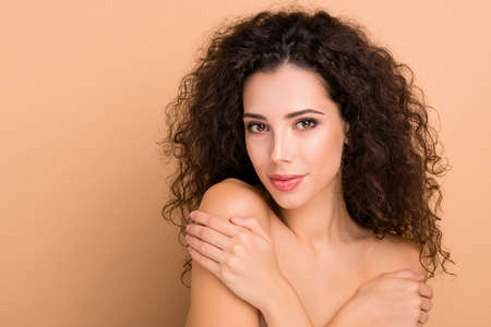 Close up photo beautiful she her lady smearing balm body shoulders skin healthy silky shiny ideal condition use new soap gel shower bath hold herself hands wearing no clothes isolated beige background 写真素材