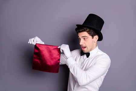 Funny funky magician start his wonderful focus hold hand red napkin look say abracadabra wear white shirt black bowtie hat isolated over grey color background