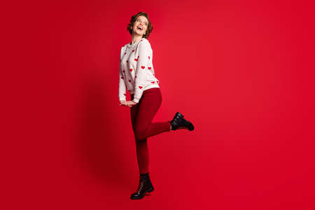Full length body size view of her she nice attractive lovely charming pretty cute cheerful cheery glad girl posing having fun wearing festal look isolated on bright vivid shine vibrant red color background Reklamní fotografie