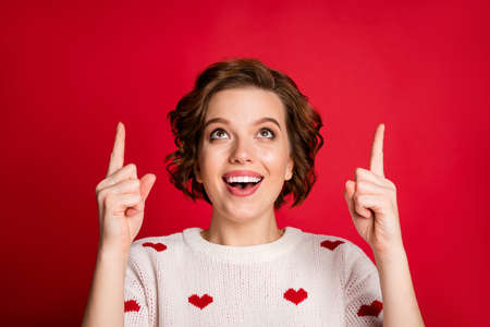 Close-up portrait of her she nice attractive lovely cute cheerful cheery glad girl pointing up surprise gift present solution isolated over bright vivid shine vibrant red color background