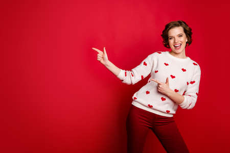 Portrait of her she nice attractive lovely cheerful cheery glad girl showing copy space, cool solution tips feedback advert isolated over bright vivid shine vibrant red color background