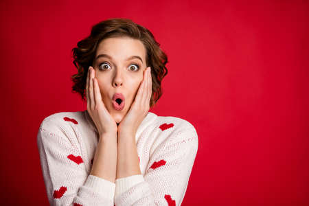 Close up photo of astonished crazy girl look unbelievable unexpected novelty impressed scream touch hands face cheeks isolated over vivid color background