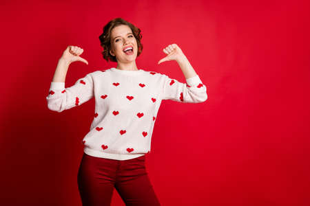 Look i best. Portrait of crazy cheerful positive girl point herself forefinger show her stylish trendy heart design jumper wear pants trousers isolated over bright color background