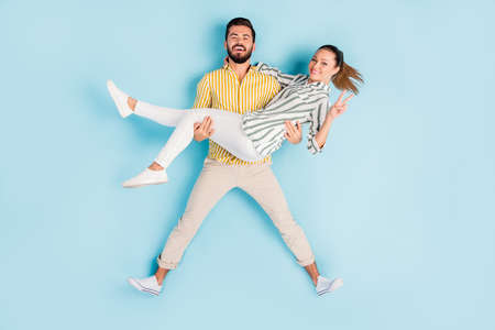 Top view above high angle flat lay flatlay lie concept full length body size view of nice couple guy carrying girl showing v-sign isolated on bright vivid shine, vibrant blue turquoise color background