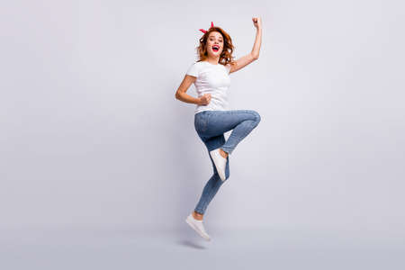 Full length body size view of her she nice attractive lovely lucky cheerful cheery girl jumping wearing casual clothes rejoicing having fun attainment isolated over light white pastel color background