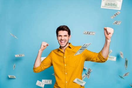 Photo of screaming, trendy style shouting crazy freelancer earning lots of money every day smiling toothily isolated over blue pastel color background Фото со стока