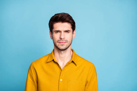 Photo of thoughtful strict manager standing confidently glancing at you candidly, isolated over blue pastel color background