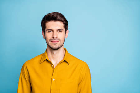 Photo of attractive brunet haired business man standing confidently near empty space isolated over pastel color background
