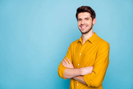Profile side view portrait of his he nice attractive content cheerful cheery brown-haired guy folded arms isolated over bright vivid shine vibrant blue green turquoise color background