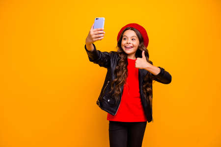 Portrait of her she nice attractive glad cheerful cheery long-haired girl taking making selfie showing thumbup blogging isolated over bright vivid shine vibrant yellow color background