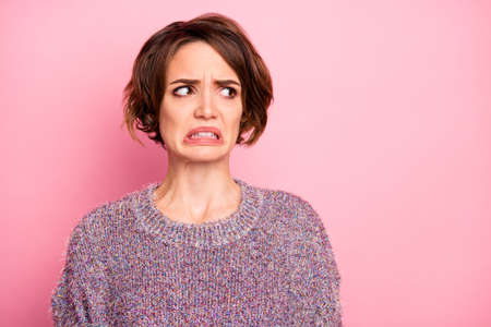 Close-up portrait of her she nice attractive lovely pretty brown-haired girl unpleasant look reaction grimacing isolated over pink pastel color background Stok Fotoğraf