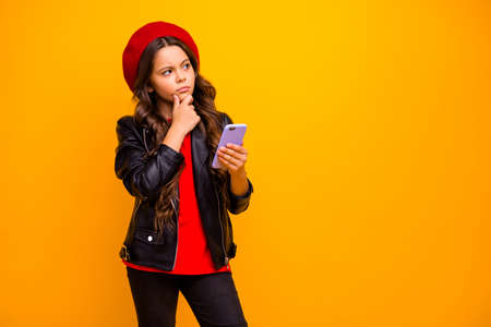 Portrait of her she nice attractive trendy bewildered long-haired girl wearing streetstyle using cell creating new post isolated over bright vivid shine vibrant yellow color background