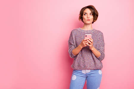 Portrait of her she nice attractive lovely pretty charming bewildered curious brown-haired girl using cell creating new post isolated over pink pastel color background Stock Photo