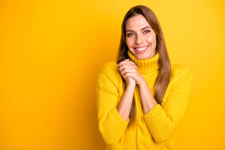 Portrait of cheerful candid girl feel grateful admire gift present she get on holidays make fists palms smiling wear bright pullover isolated over vivid color background