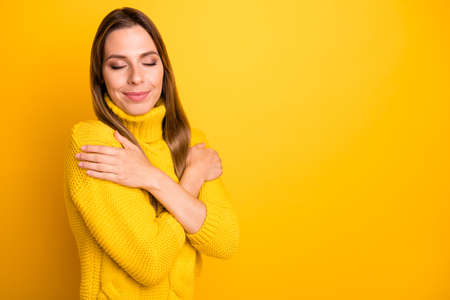Turned photo of lovely girl feel quiet candid emotions hug herself wear soft warm knitted pullover isolated over bright color background