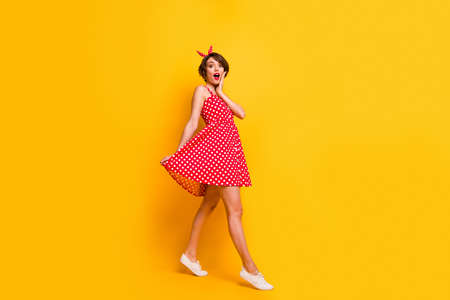 Full size photo of astonished girl walk go see incredible black friday bargain impressed scream touch hands face wear good look clothes isolated over bright color background