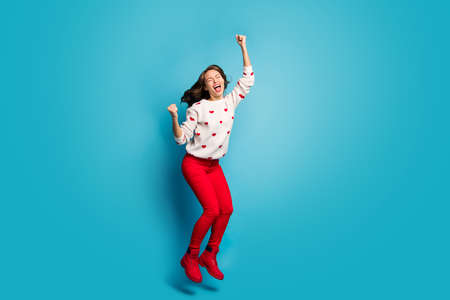 Full length body size view of her she nice attractive lovely cheerful cheery overjoyed ecstatic glad girl jumping having fun theme party isolated on bright vivid shine vibrant blue color background