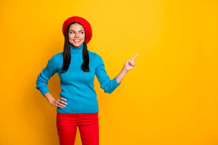 Portrait of her she nice attractive lovely pretty confident cheerful cheery girl pointing ad advert decision solution like follow isolated over bright vivid shine vibrant yellow color background