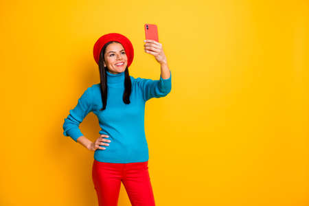 Portrait of her she nice attractive lovely pretty cheerful cheery girl stylist image maker making taking selfie having fun isolated over bright vivid shine vibrant yellow color background Banco de Imagens - 138271758
